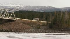 Ore Truck on Stikine River Bridge on Cassiar Hwy Stock Footage