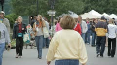 Stock Footage - Ladies talking as a large crowd walks downtown Stock Footage
