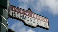 Fashion District Street Sign CU Stock Footage