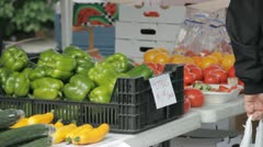 Stock Footage - Med Close up - Shopper at Famers Market - Great Color! Stock Footage