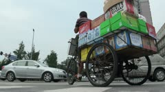 A man has to deliver goods on a tricycle, he is on the phone, China Stock Footage