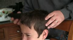 120511 Boy getting home haircut 2 Stock Footage