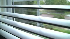 Rain through the blinds - stock footage