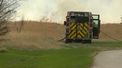 grassfire, heavy smoke truck and flames - stock footage