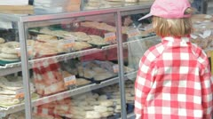 Stock Footage - Young girl with mother at Dutch Bakery - Picking out selection - stock footage