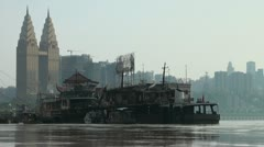 Contrast along the Yangtze river: brand new skyline and old living boats Stock Footage