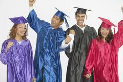 Group of graduates wearing caps and gowns Stock Photos