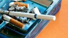 Cigarette burning in the ashtray Stock Footage