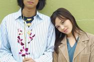 Young woman leaning her head on boyfriend's shoulder Stock Photos