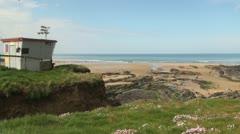 Lifeguard Station Overlooking Bude Beach, Cornwall, England, UK Stock Footage