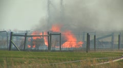 Grassfire, debris burning long shot Stock Footage