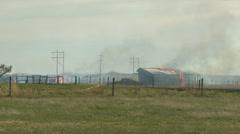 Fire, grassfire, small barn burning medium shot Stock Footage