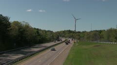 Wind turbine and Highway traffic 00019RW Stock Footage