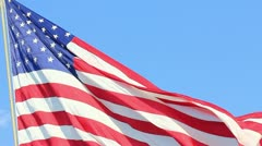 closeup of jumbo american flag against a blue sky - hd - 1920x1080 - stock footage