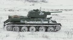 Legendary Russian Tank T34 in snowy weather Stock Footage