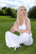 woman meditating and looking to heaven - stock photo