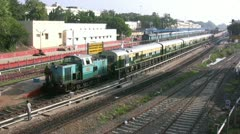 Train rolls out of a station in India Stock Footage