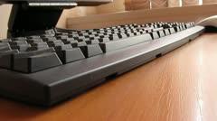 Man working on computer keyboard - stock footage