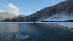 Source of water in the lake in winter - stock footage