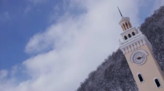 Clock tower on sky background and the forest timelapse Stock Footage