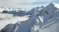 Snow-covered mountains and clouds timelapse Stock Footage
