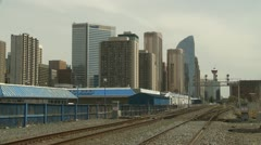 Calgary skyline with CP rail main line wide shot Stock Footage