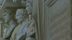 Rack focus Ancient Roman statues to Ancient text Stock Footage