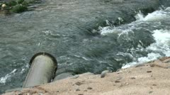 Pipeline into Flowing River Water Stock Footage