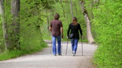 Nordic walking couple Stock Footage