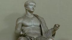 Roman ancient statue, tourists walk past Stock Footage