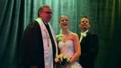 Bride and Groom with Priest Getting Picture Taken - stock footage