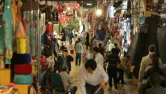 People walking along busy shopping alley with shopkeepers working (HD) c Stock Footage