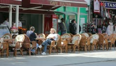 Outdoor cafe at roadside Stock Footage