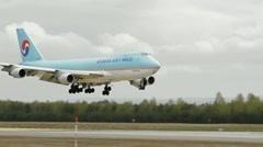 Huge jumbo jet Boeing 747 aircraft landing Stock Footage