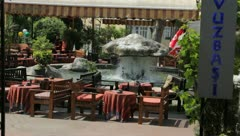 Rock fountain at outdoor restaurant (HD) c Stock Footage