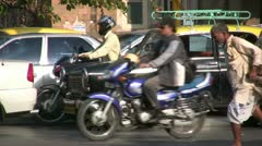 Workers carrying cart with heavy boxes through traffic in Mumbai Stock Footage