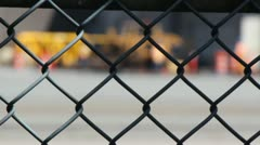 Chain Link Fence with Flurred Background Workers Stock Footage