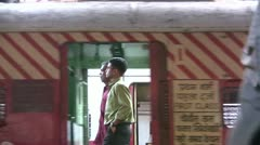 Close up of a train station from a moving train in Mumbai, India Stock Footage