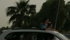 People riding in sunroof (HD) c Stock Footage