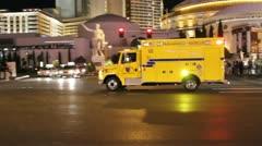 Ambulance on Las Vegas Blvd at night Stock Footage