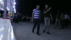 People walking past lit game booths (HD) c Stock Footage