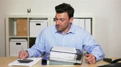 Personnel manager reading job application Stock Footage
