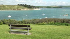 Empty Bench Overlooking Camel Esturary towards Rock, Cornwall, England Stock Footage