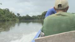 Suriname, boating on the Palumeu lake Stock Footage