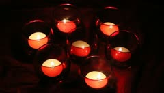 Seven red votives Stock Footage