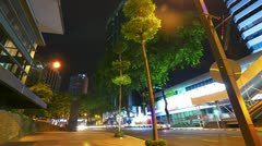 Modern city street at night, timelapse in motion Stock Footage