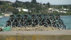 Lobster Pots on Harbour Wall Stock Footage