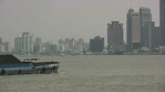 Coal ship sails through the centre of Shanghai, China - stock footage