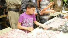 Iraqi child making meat patties (HD) c Stock Footage