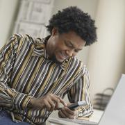 african man using cell hone - stock photo